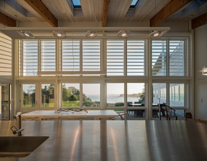 Generous windows and skylights invite sunlight into the central room.