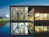 The head office for St-Germain gouts et Aqueducs floats above an artificial pool. Marc Cramer