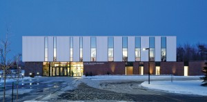 Exterior image of the aquatic centre in Saint-Hyacinthe, completed with TLA. James Brittain