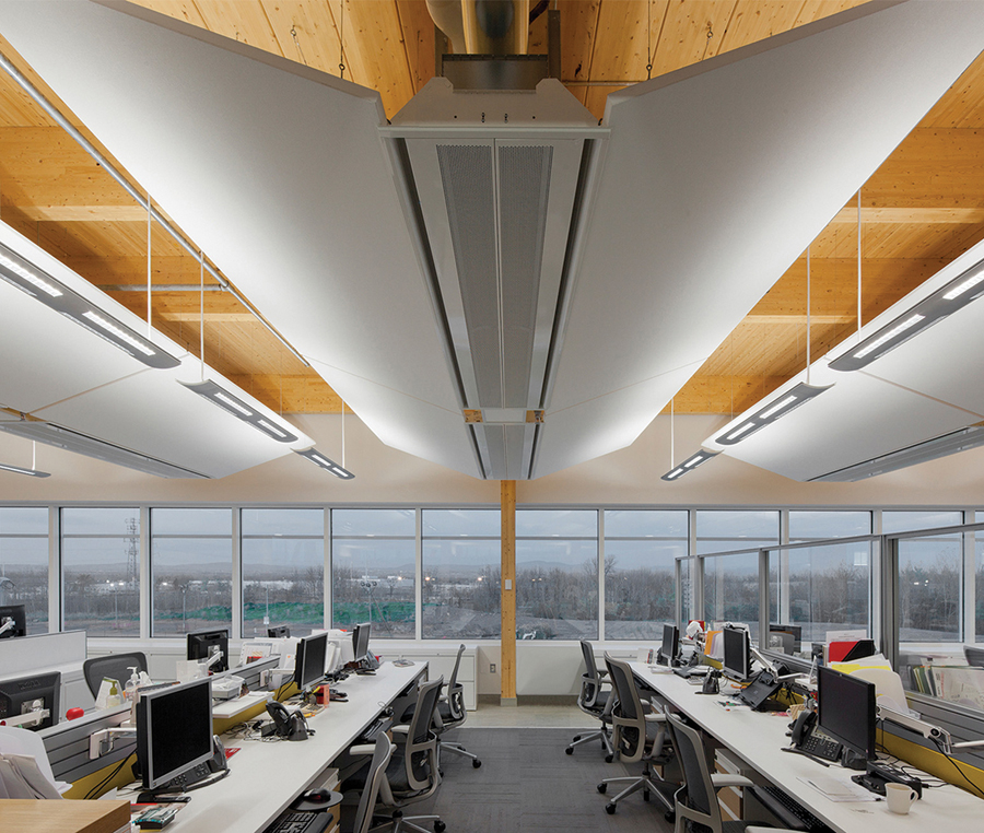 Butterfly-like ceiling structures integrate HVAC, lighting and acoustic functions.