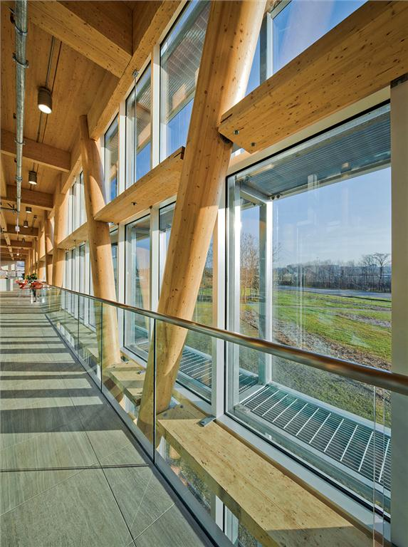 Service walkways double as solar shading within the double-skin wall.
