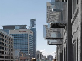 Balconies jut out from the building at different depths, creating a dynamic faade and encouraging social interaction.