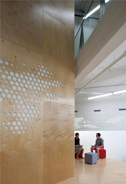 The honeycomb motif weaves through the partitions.