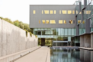 The researcher office wing overlooks a reflecting pool.