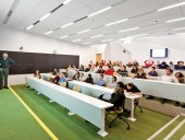 A classroom features terraced seating.