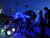people-powered bicycles light up the night sky in downtown toronto. photo by bob gundu.