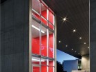 In contrast to a fairly monochromatic material palette, red walls in the stairwell deliver cinematic punch. Ema Peter
