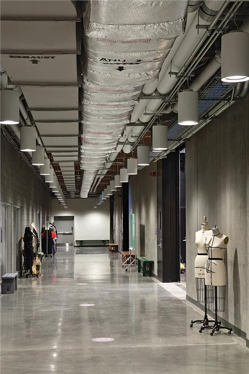 Dressmaker's dummies on the polished concrete floor of the lowest-level corridor offer a clue about the costuming functions taking place. Ema Peter