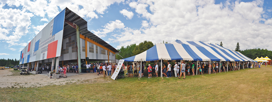 During the week-long folk festival, the backstage kitchen serves 10,000 meals a day. The structure provides festival-goers with welcome respite from sun and rain.
