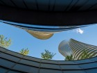 Looking up from ground level at the podium's planted roof and the two Absolute World towers above.