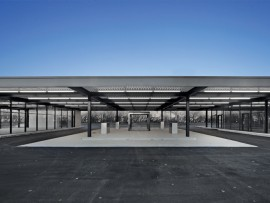The adaptive reuse of Mies van der Rohe's Gas Station on Nuns' Island retains the original steel structure, including columns made of square-edged plates fastidiously welded to form I-beams. On the former filling island, four gas pumps have been converted to geothermal air intakes, while the teller's booth becomes an enigmatic glass box.
