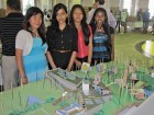 Young participants from No. 9's Imagining My Sustainable City school program stand alongside their model at Toronto's Metro Hall. No.9