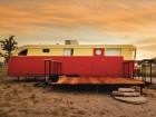 A renovated red vintage trailer offers unique accommodation on the 18-acre El Cosmico nomadic hotel and campground in Marfa, Texas. Nick Simonite