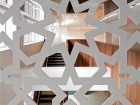 A close-up of a laser-cut lattice from the second floor.