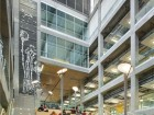 Natural daylight floods into the atrium, the social heart of the EEEL facility.