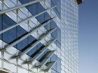 On the building's east and west sides, aluminum fins provide effective shading while minimizing interference with views.