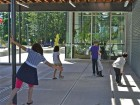 A view of the sheltered outdoor area at the east end of the school during lunch recess. McFarland Marceau Architects