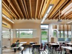 Classroom amenities include a reading nook at back left, moveable partitions at the front and right side, and a learning resource wall with a projection screen and Smartboard at left.