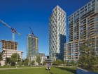 The 35-storey 428-unit tower and podium at 150 Dan Leckie Way is articulated with rhythmic black and white faades.