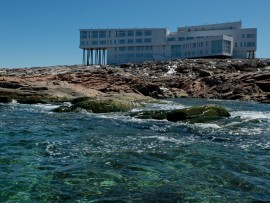 Situated on the windswept Back Western Shore of Joe Batt's Arm, the Fogo Island Inn's craggy, layered volumes echo the forms of nearby sea-worn rock formations.