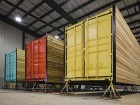 Reclad in cedar siding with their back ends painted in cheerful hues, the reconfigured trailers are seen prior to site delivery. Mat Piller