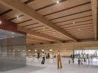The check-in hall includes a cross-laminated timber wall and glulam beams.