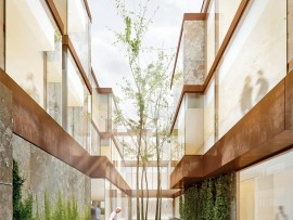 A private courtyard is visible from community spaces and each of the patient rooms.