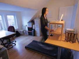 Canadian Architect editor Elsa Lam works at her treadmill desk at her home office.