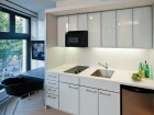 The kitchens include space-saving two-burner stoves and counter-height fridges. Martin Knowles