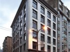 The glazed-tile heritage front of the century-old Burns Block was fully restored as part of its conversion from SRO to micro-apartment units. Derek Lepper