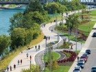 The promenade integrates designated paths for pedestrians and cyclists alongside native plantings