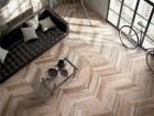 Inspired by wooden wine barrel staves, ABK's subtly hued Soleras tiles are used to create a French herringbone pattern.