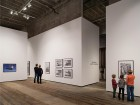 Monte Clark's main gallery space is defined by a roughly irregular and grooved concrete floor below and a soaring ceiling above, accommodating even the most outsized and monumental works. silentSama Architectural Photography