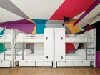 Standard dorm rooms are enlivened with colourful geometric murals.