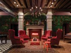 A handcrafted stone fireplace equipped with an ironic neon sign forms a centrepiece for the lobby.