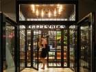 The chandelier-lit vestibule to the luxe hostel.