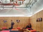 A site-specific art piece animates the reception area ceiling.