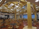 A view of the central space, which serves as dining area, meeting commons, and gathering space at different times of the day. Basic construction techniques were used throughout the complex to mitigate the risks associated with lost or damaged materials, which would be expensive to replace. Harriet Burdett-Moulton