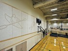 Sketches of Northern sports and games are etched into the acoustic panels encircling the gymnasium.