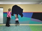 Colourful Arctic animal murals adorn the kindergarten hallways.