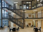 Each of the inmate pods is a largely self-contained unit with outdoor access.