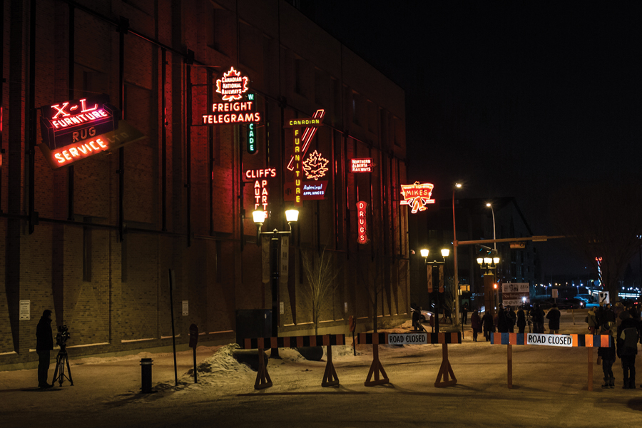 An outdoor museum was created via salvaged neon signs that now animate the brick faade of a utility building in Edmonton's warehouse district. Tom Young