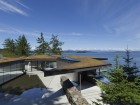The irregular geometries of the Tula House mimic those of its dramatic site on Quadra Island.