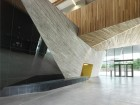 Expressive forms and textural contrasts define the ground-floor public spaces.