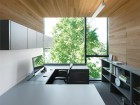 The clean efficiency of the offices and meeting rooms is enhanced by wrap-around cedar walls and ceilings, framing views of the lush BC landscape.