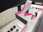 Hot pink was chosen to accentuate the fluid organic circulation of the central atrium stair. Maris Mezulis