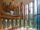 White oak panels modulate light and views in the glazed two-storey chapel. James Dow