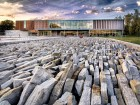 The entry sequence to the library is defined by a vast poetic rocky landscape--which also serves as a retention pond for surface water runoff. Julien Perron-Gagn