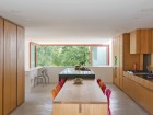 A central family gathering space, the open kitchen and dining area dominates the main floor of the house. The integration of kitchen island and harvest dining table picks up on the firm's earlier investigations into the notion of family and community cohesion through food.