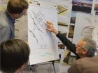Busby discusses a transportation project with collaborators. Perkins+Will